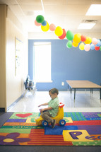 toddler boy playing in a church nursery