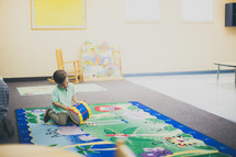 child playing in a church nursery