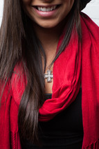 cross necklace and red scarf on an African-American woman