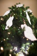 angel ornaments on a Christmas tree