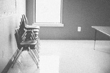 stacked chairs in an empty classroom