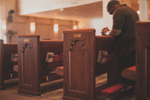 man praying in a church