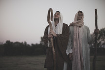 shepherds with staffs praying