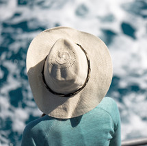woman on a boat in a sunhat