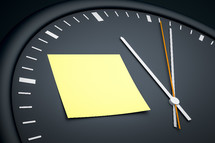 sticky note on a clock