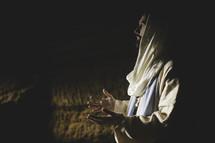 Jesus in prayer in a tomb
