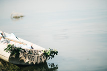just married sign on the back of a row boat