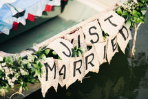 just married on the back of a row boat
