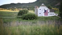 American flag hanging on a barn