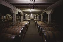 barrels of wine in a winery cellar