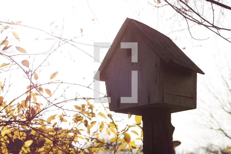 birdhouse on a post