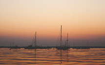 Boats on the water at sunset