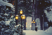 snow on street lamps