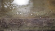 falling snow on rock