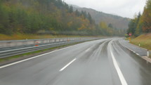 vehicle traveling on a wet road