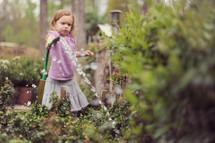 girl child watering a garden