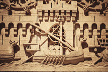 carving in stone of an ancient ship