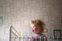 toddler girl in her crib