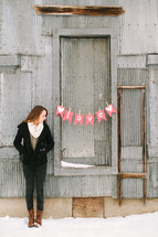 a girl standing near a love banner