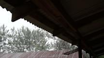 heavy rain falling on a school house roof in Kenya