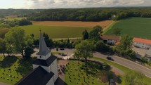 drone flight over a rural church with cemetery
