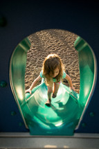 Girl climbing playground slide