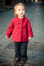 toddler girl wearing a red peacoat