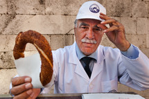 Muslim, Turk, Turkish man offering Simit