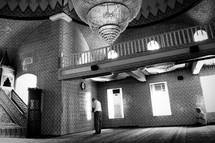 man in prayer inside a mosque
