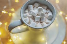 fairy lights and mug of hot cocoa