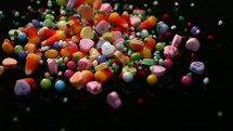 slow motion candy spilling from a bowl