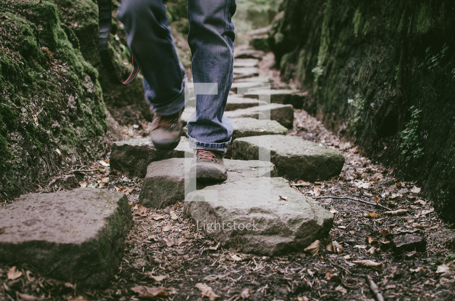a person hiking along stepping stones