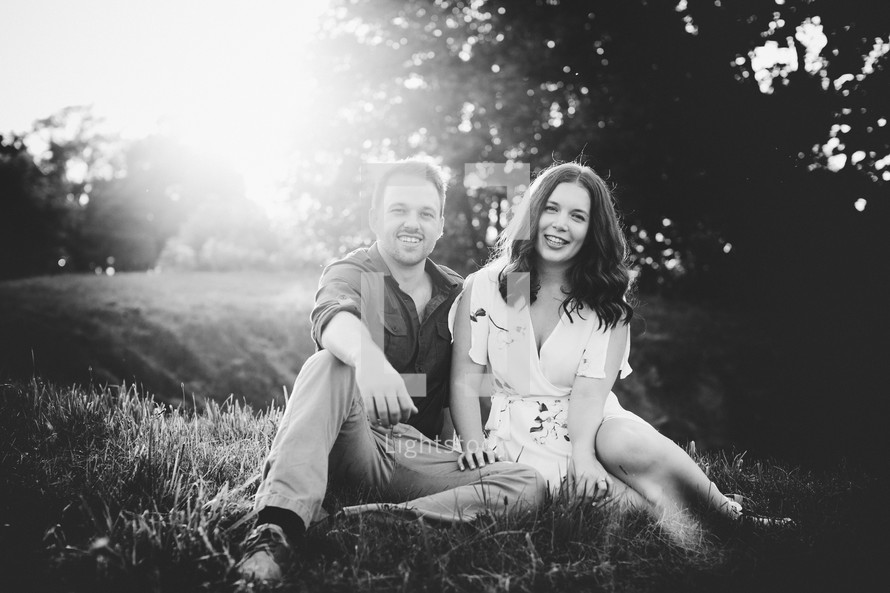 a couple sitting together in the grass
