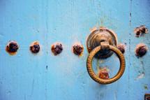 rusty door pull and blue door