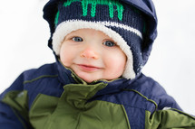 toddler boy in a snowsuit
