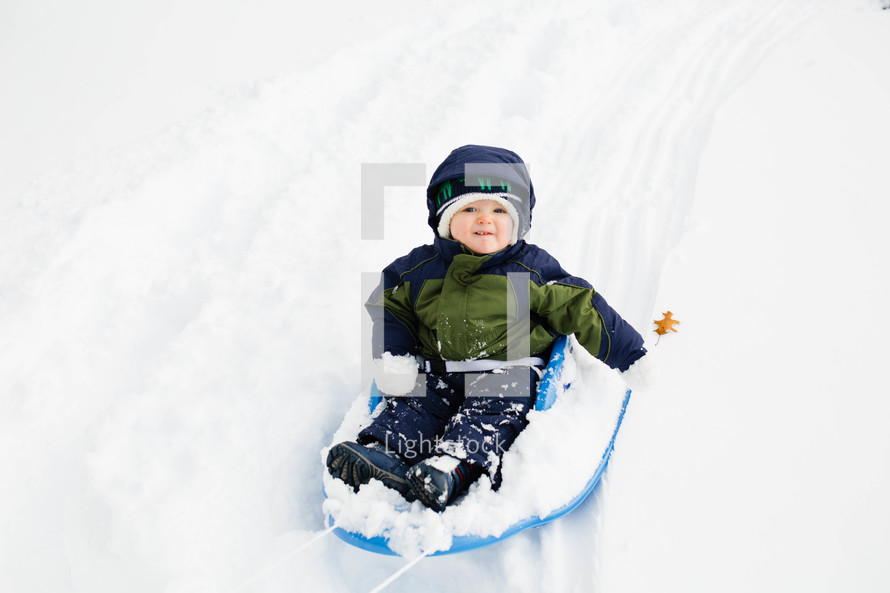 boy child in a sled