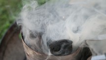 smoke from coals from a grill