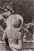 a woman in a hat on cruise ship