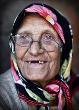 Elderly muslim woman missing teeth