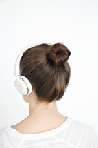 a woman listening to headphones