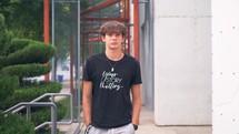 teen boy walking towards the camera - your story matters
