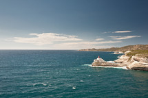 lighthouse along a shore in Korsika