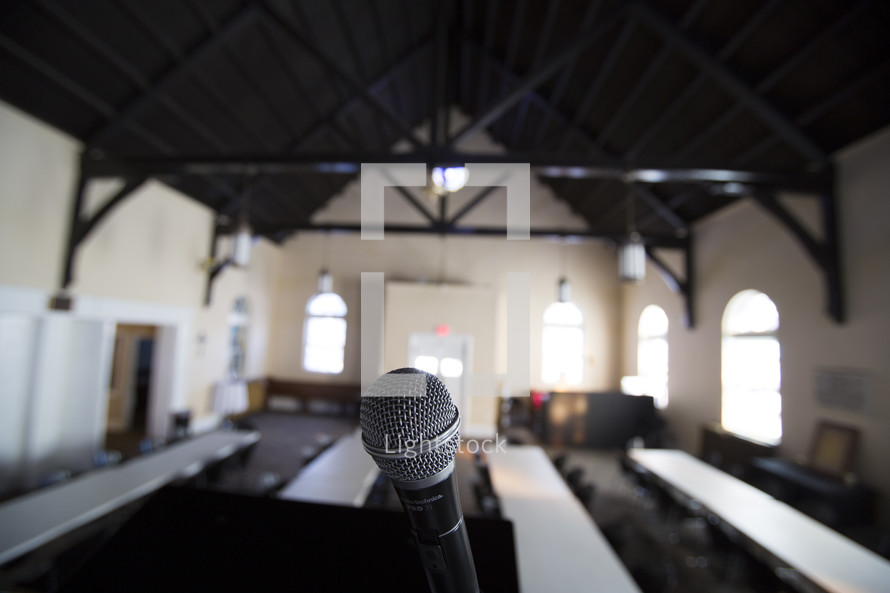 a microphone in front of a room of tables