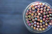 sharpened colored pencils in a mason jar