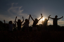 silhouettes of jumping celebrating children