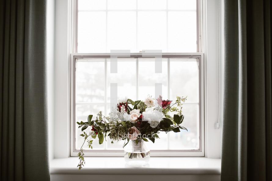 flower arrangement in a window sill