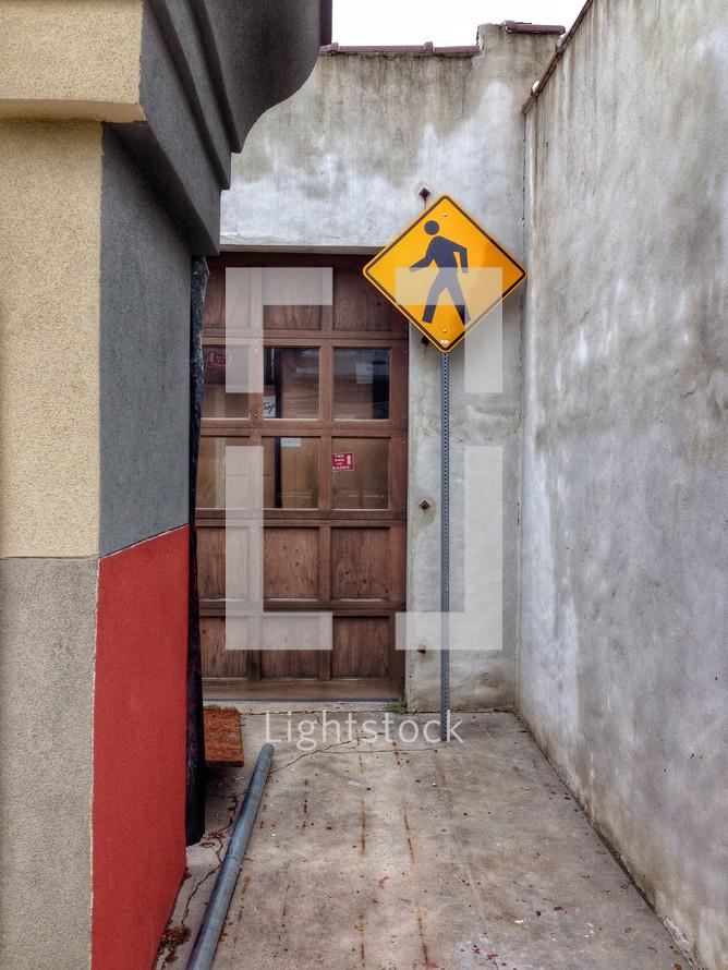 pedestrian sign in an alley