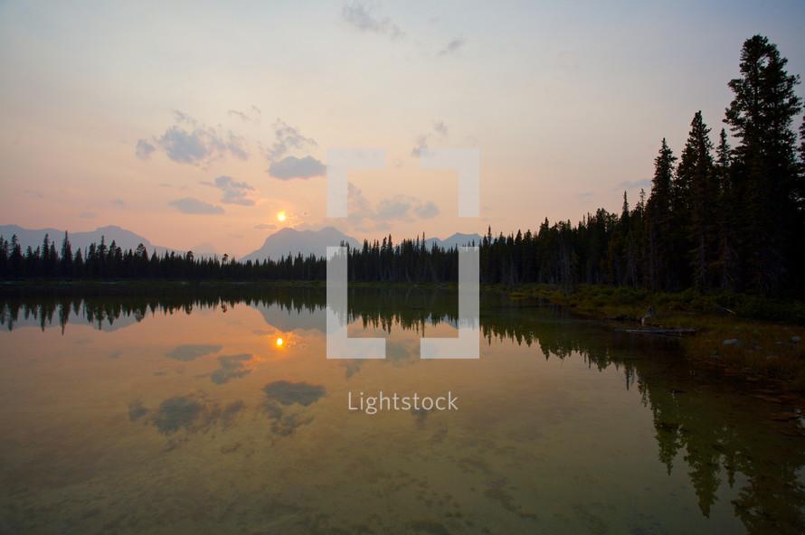 sunset reflecting on a lake