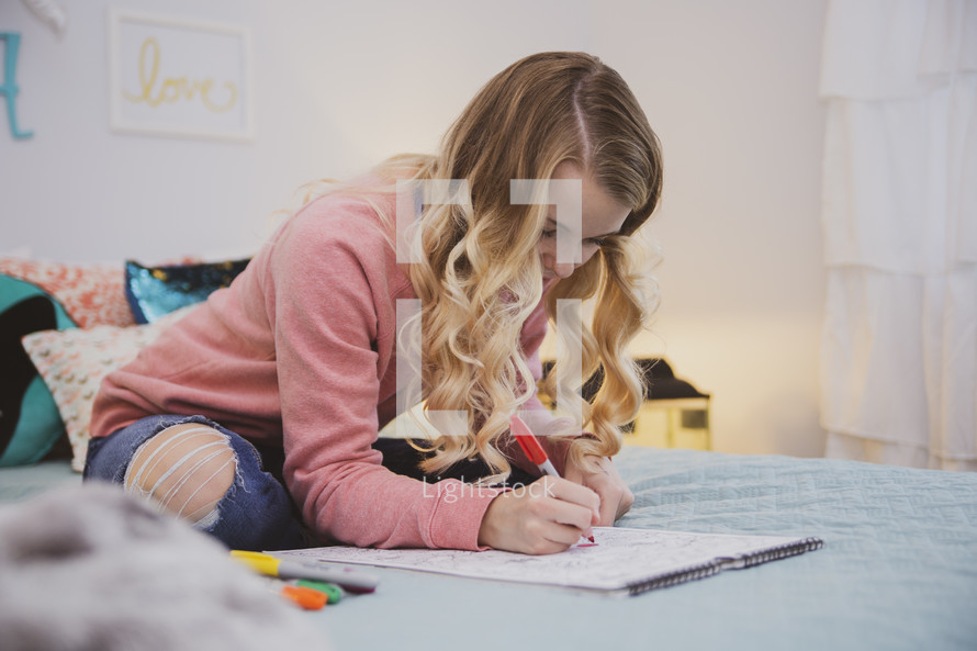 girl drawing in his room