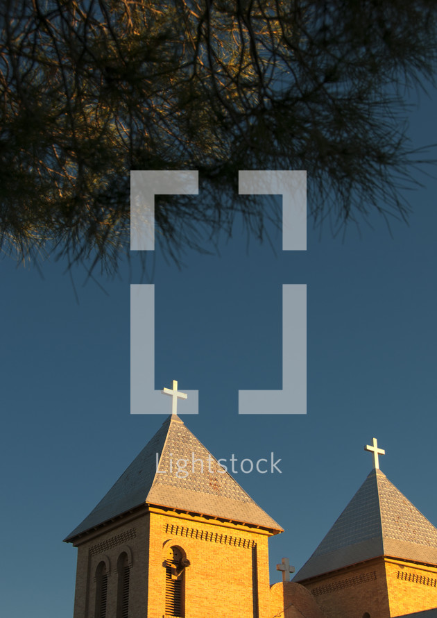 cross toppers on a church roof
